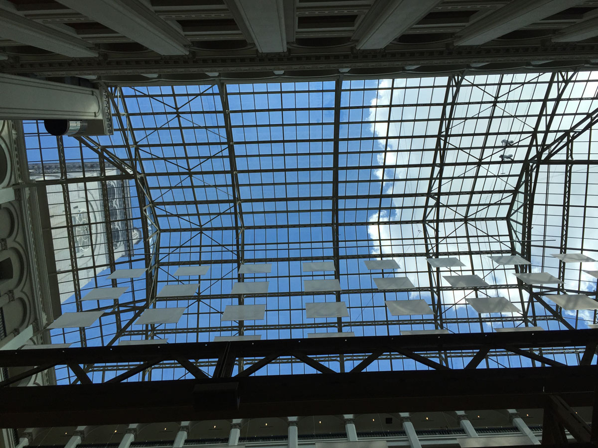 """A view of the skylight in the grand lobby of the Trump International Hotel on Pennsylvania Avenue in D.C. The hotel held a """"soft opening"""" on Sept. 12. The Trump Organization won a 60-year lease from the federal government to transform the Old Post Office building into a hotel. (WTOP photo/Rich Johnson)"""