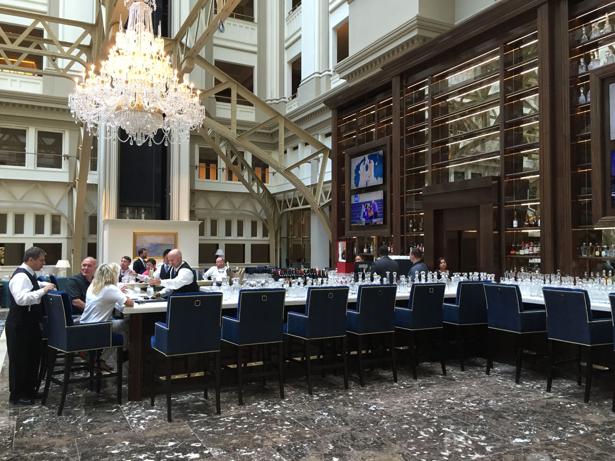 """A view of the bar in the grand lobby of the Trump International Hotel on Pennsylvania Avenue in D.C. The hotel held a """"soft opening"""" on Sept. 12. The Trump Organization won a 60-year lease from the federal government to transform the Old Post Office building into a hotel. (WTOP photo/Rich Johnson)"""