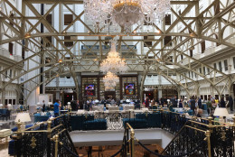 """The grand lobby of the Trump International Hotel on Pennsylvania Avenue in D.C. The hotel held a """"soft opening"""" on Sept. 12. The Trump Organization won a 60-year lease from the federal government to transform the Old Post Office building into a hotel. (WTOP photo/Rich Johnson)"""