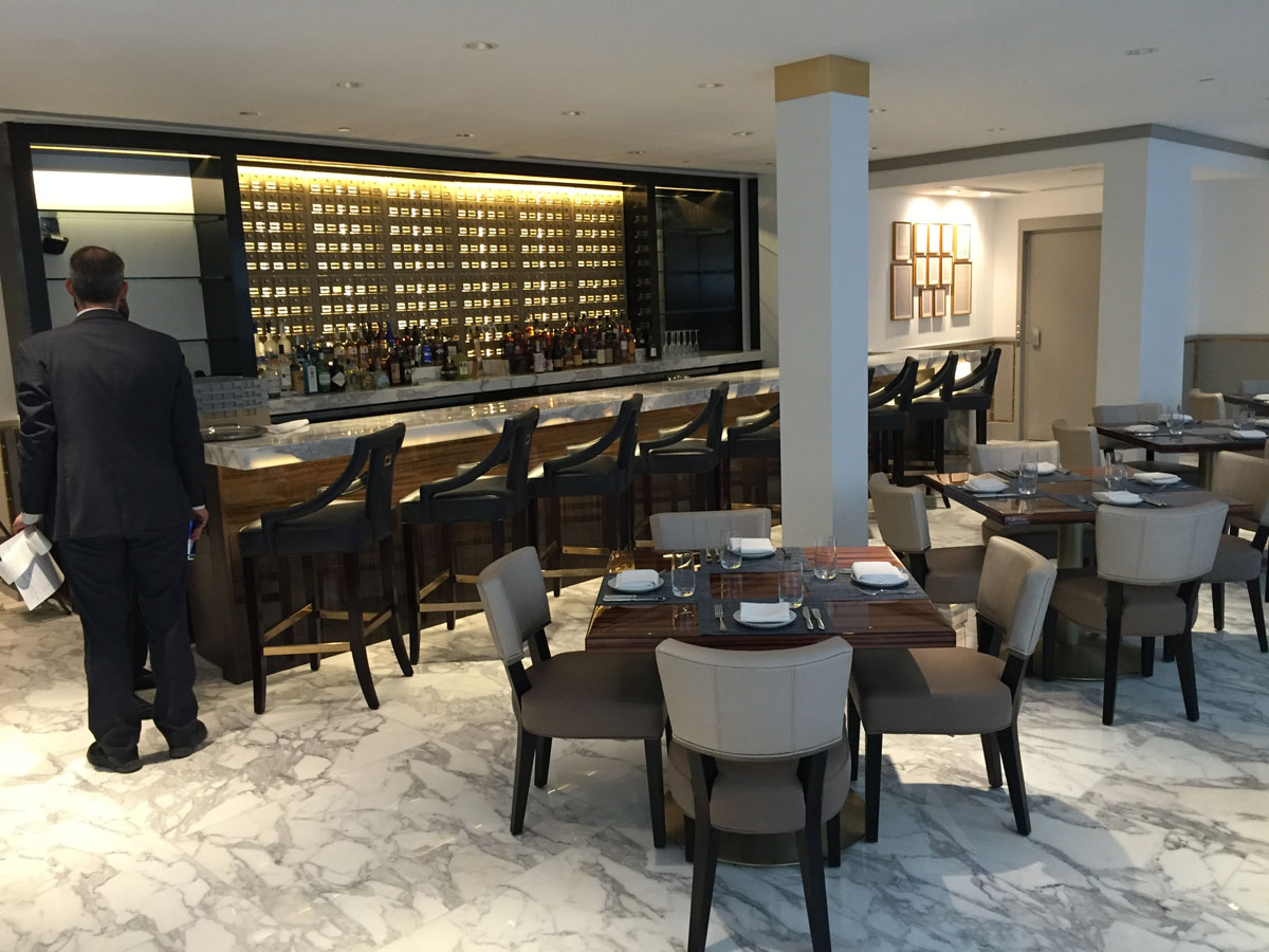 """A dining area in the Trump International Hotel on Pennsylvania Avenue in D.C. The hotel held a """"soft opening"""" on Sept. 12. The Trump Organization won a 60-year lease from the federal government to transform the Old Post Office building into a hotel. (WTOP photo/Rich Johnson)"""