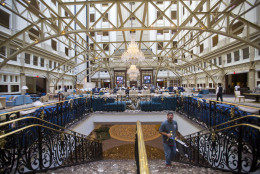 """Workers move around inside the Trump International Hotel during it's 'soft-opening' in downtown Washington, Monday, Sept. 12, 2016 in Washington. The luxury hotel Donald Trump has built in an iconic downtown Washington building is set to open. The Trump International Hotel will begin serving guests Monday. There won't be any fanfare around the opening, which is known as a """"soft opening."""" Grand-opening ceremonies are being planned for October. The Trump Organization won a 60-year lease from the federal government to transform the Old Post Office building on Pennsylvania Avenue into a hotel. (AP Photo/Pablo Martinez Monsivais)"""