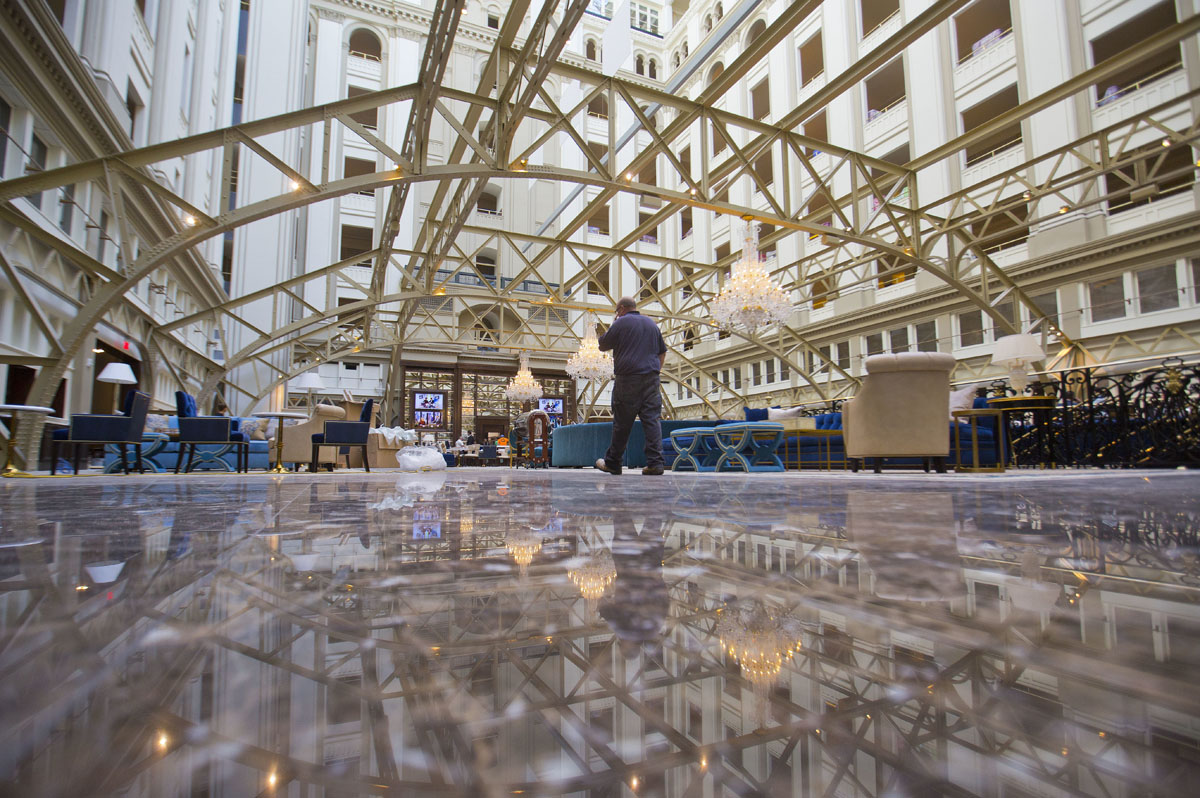 """Inside the Trump International Hotel during """"soft-opening"""" in downtown Washington, Monday, Sept. 12, 2016 in Washington. The luxury hotel Donald Trump has built in an iconic downtown Washington building is set to open. The Trump International Hotel will begin serving guests Monday. There won't be any fanfare around the opening, which is known as a """"soft opening."""" Grand-opening ceremonies are being planned for October. The Trump Organization won a 60-year lease from the federal government to transform the Old Post Office building on Pennsylvania Avenue into a hotel. (AP Photo/Pablo Martinez Monsivais)"""