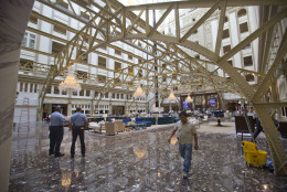 """Main lobby of the Trump International Hotel in downtown Washington, Monday, Sept. 12, 2016. The luxury hotel Donald Trump has built in an iconic downtown Washington building is set to open. The Trump International Hotel will begin serving guests Monday. There won't be any fanfare around the opening, which is known as a """"soft opening."""" Grand-opening ceremonies are being planned for October. The Trump Organization won a 60-year lease from the federal government to transform the Old Post Office building on Pennsylvania Avenue into a hotel. (AP Photo/Pablo Martinez Monsivais)"""