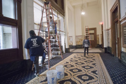 """Work continues inside the Trump International Hotel in downtown Washington, Monday, Sept. 12, 2016 in Washington. The luxury hotel Donald Trump has built in an iconic downtown Washington building is set to open. The Trump International Hotel will begin serving guests Monday. There won't be any fanfare around the opening, which is known as a """"soft opening."""" Grand-opening ceremonies are being planned for October. The Trump Organization won a 60-year lease from the federal government to transform the Old Post Office building on Pennsylvania Avenue into a hotel. (AP Photo/Pablo Martinez Monsivais)"""