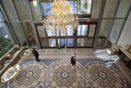"""11th street lobby entrance to the Trump International Hotel in downtown Washington, Monday, Sept. 12, 2016 in Washington. The luxury hotel Donald Trump has built in an iconic downtown Washington building is set to open. The Trump International Hotel will begin serving guests Monday. There won't be any fanfare around the opening, which is known as a """"soft opening."""" Grand-opening ceremonies are being planned for October. The Trump Organization won a 60-year lease from the federal government to transform the Old Post Office building on Pennsylvania Avenue into a hotel. (AP Photo/Pablo Martinez Monsivais)"""