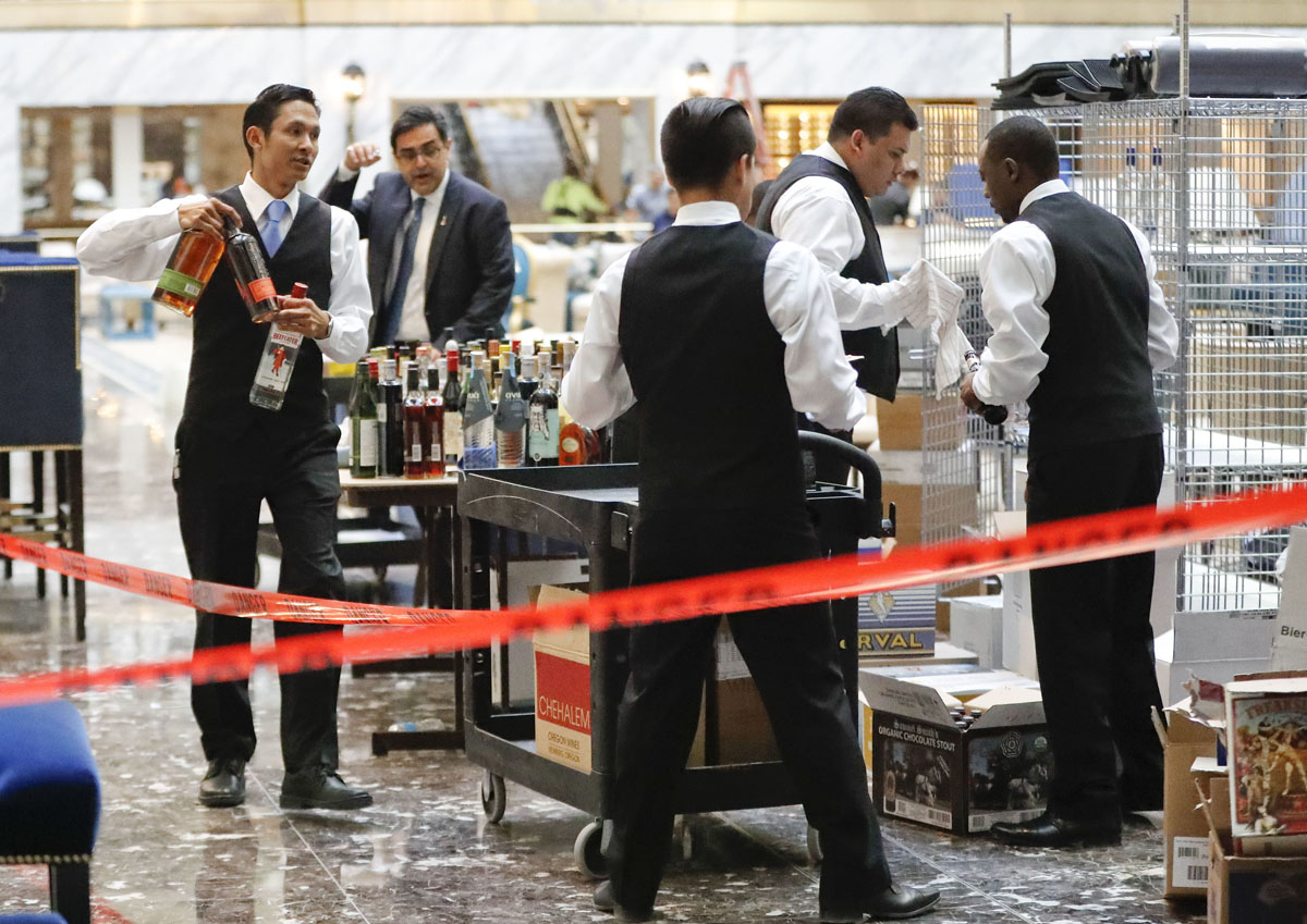 """Workers begin to stock the bar with liquor at the Trump International Hotel in downtown Washington, Monday, Sept. 12, 2016 in Washington. The luxury hotel Donald Trump has built in an iconic downtown Washington building is set to open. The Trump International Hotel will begin serving guests Monday. There won't be any fanfare around the opening, which is known as a """"soft opening."""" Grand-opening ceremonies are being planned for October. The Trump Organization won a 60-year lease from the federal government to transform the Old Post Office building on Pennsylvania Avenue into a hotel. (AP Photo/Pablo Martinez Monsivais)"""