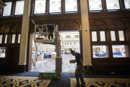 """Work continues inside as the final details are made to the lobby area of the Trump International Hotel in downtown Washington, Monday, Sept. 12, 2016. The luxury hotel Donald Trump has built in an iconic downtown Washington building is set to open. The Trump International Hotel will begin serving guests Monday. There won't be any fanfare around the opening, which is known as a """"soft opening."""" Grand-opening ceremonies are being planned for October. The Trump Organization won a 60-year lease from the federal government to transform the Old Post Office building on Pennsylvania Avenue into a hotel. (AP Photo/Pablo Martinez Monsivais)"""