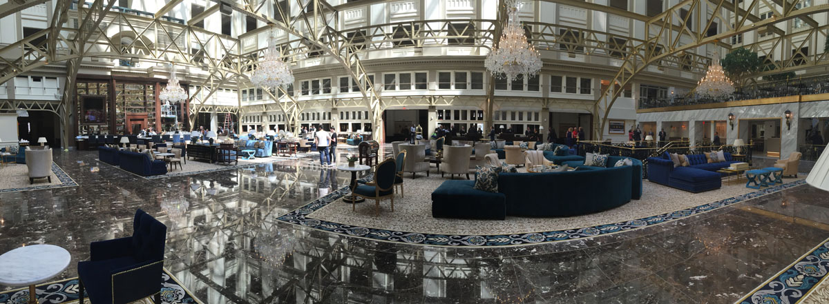 """A panorma of the grand lobby of the Trump International Hotel on Pennsylvania Avenue in D.C. The hotel held a """"soft opening"""" on Sept. 12. The Trump Organization won a 60-year lease from the federal government to transform the Old Post Office building into a hotel. (WTOP photo/Rich Johnson)"""