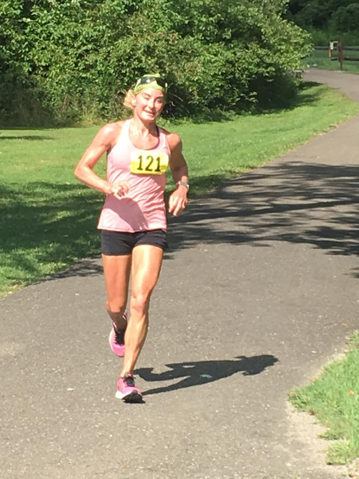 Brooke Sydnor Curran is the founder of RunningBrooke, a nonprofit that renovates playgrounds in Alexandria, Va., neighborhoods where most of the children are younger than 5. This photo was taken on Aug. 7, 2016, after her 98th marathon. Her first marathon was the Marine Corps Marathon in 2004. This year's Marine Corps Marathon, scheduled for Oct. 30, 2016, will be her 100th. (Courtesy Brooke Sydnor Curran)
