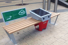 The D.C. Department of Parks and Recreation installed the first Soofa smart bench in the  Columbia Heights Civic Plaza on 14th and Park Road in Northwest D.C. (WTOP/Jack Moore)