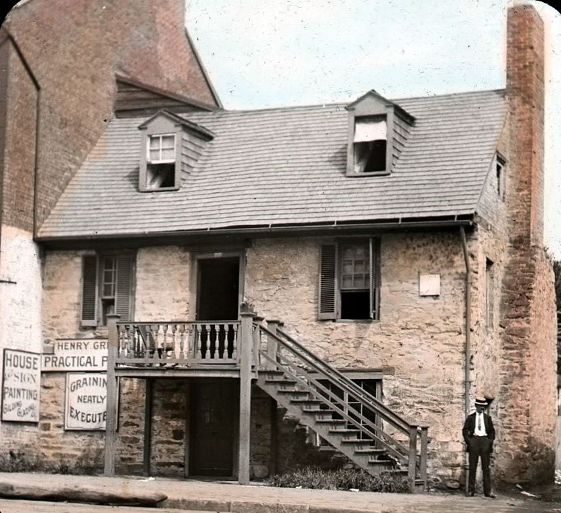 The front of the Old Stone House on M Street in Georgetown seen in an  1890 photograph. (D.C. Public Library Commons)