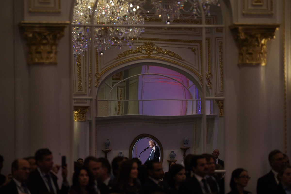 Republican presidential candidate Donald Trump is reflected in a mirror as he speaks during the grand opening of the Trump International Hotel- Old Post Office, Wednesday, Oct. 26, 2016, in Washington. (AP Photo/ Evan Vucci)