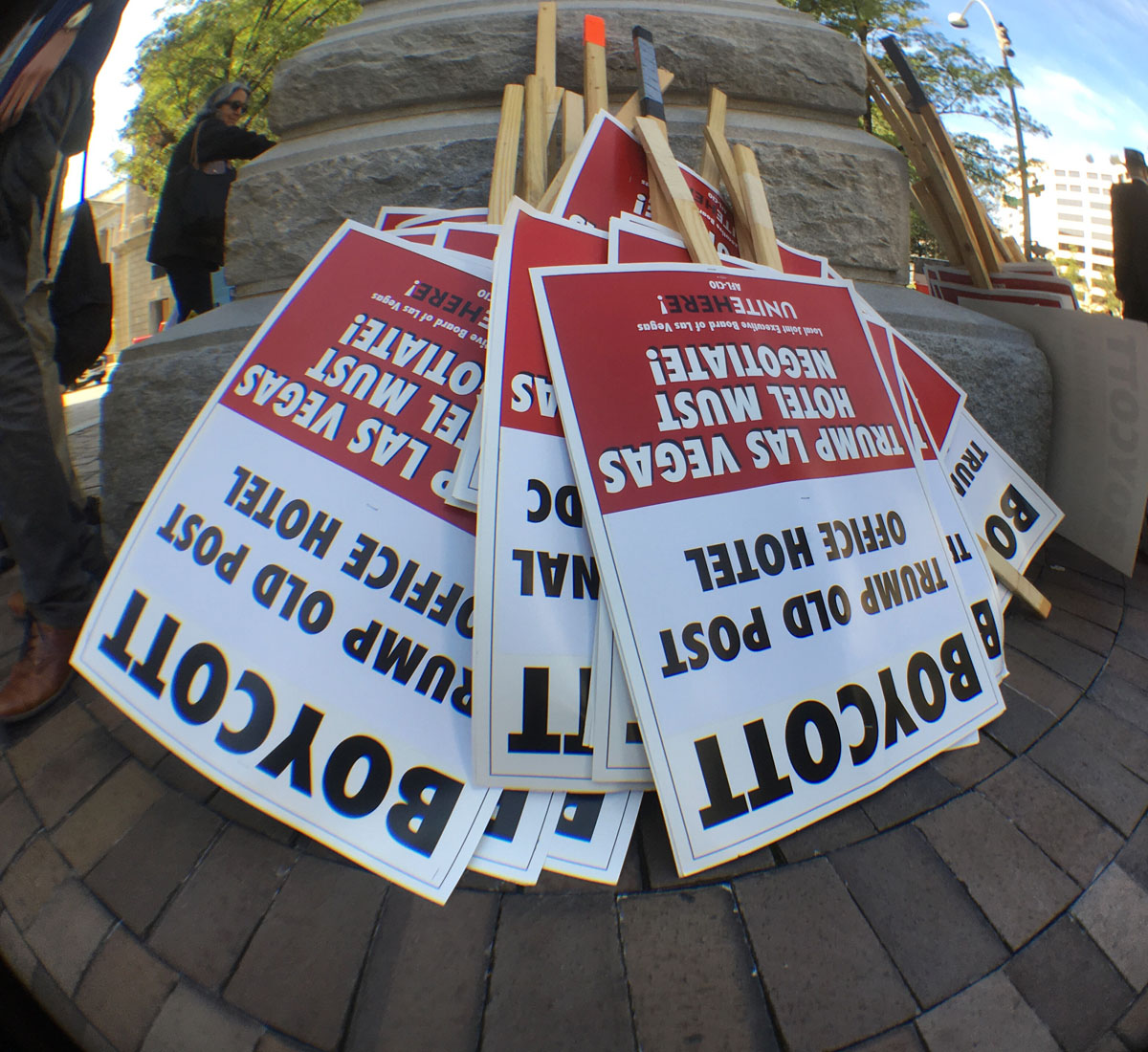 Signs at the protest by unions supporting Trump Hotel workers in Las Vegas. (WTOP/Kate Ryan)