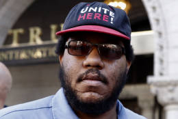 """Josh Armstead is a dining hall worker at Georgetown University.  He's a union member and says he was protesting in support of Trump hotel workers in Las Vegas. The employees at Trump's Las Vegas hotel won the right to unionize, but say Trump's refused to come to the bargaining table, so Unite HERE a labor group representing hotel and hospitality workers, was out in front of the Trump International Hotel in Washington DC urging a boycott of the new DC hotel. """"We demand respect! And that's why I'm out here. I got my respect at my job when we won the union. I have rights. The workers in Las Vegas, they don't have rights. They need for Donald Trump to actually sit down. If he wants to make America great again he needs to start there!"""" (WTOP/Kate Ryan)"""