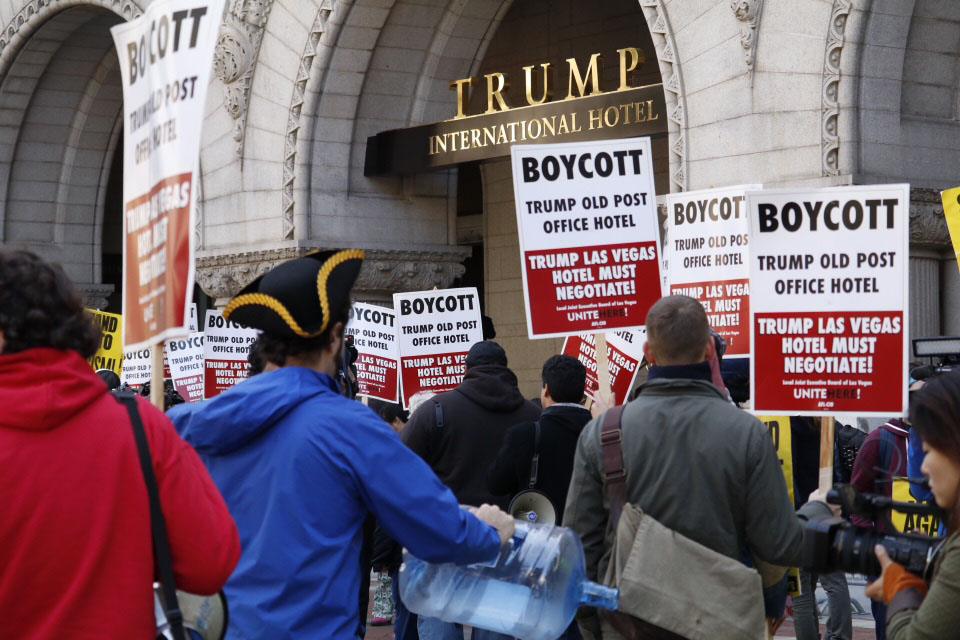 Protesters outside the Trump International Hotel Oct. 26, protesting the hotel's official opening. (WTOP/Kate Ryan)