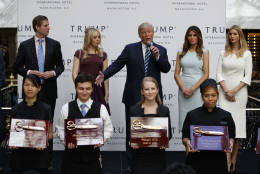 Republican presidential candidate Donald Trump, accompanied by, from left, Donald Trump Jr., Tiffany Trump, Melanie Trump and Ivanka Trump,  speaks during the grand opening of the Trump International Hotel- Old Post Office, Wednesday, Oct. 26, 2016, in Washington. (AP Photo/ Evan Vucci)