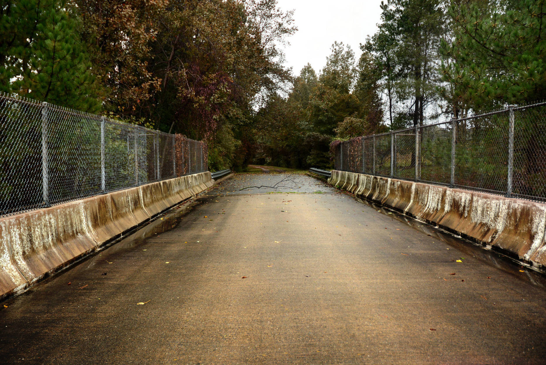 Farm Road Bridge – Crownsville, Md.  The Farm Road overpass above Interstate 97 marks the route along which deceased patients from the shuttered Crownsville Mental Hospital were taken to burial. The hospital's old cemetery lies on a quiet hill at the end of the road. (WTOP/Dave Dildine)