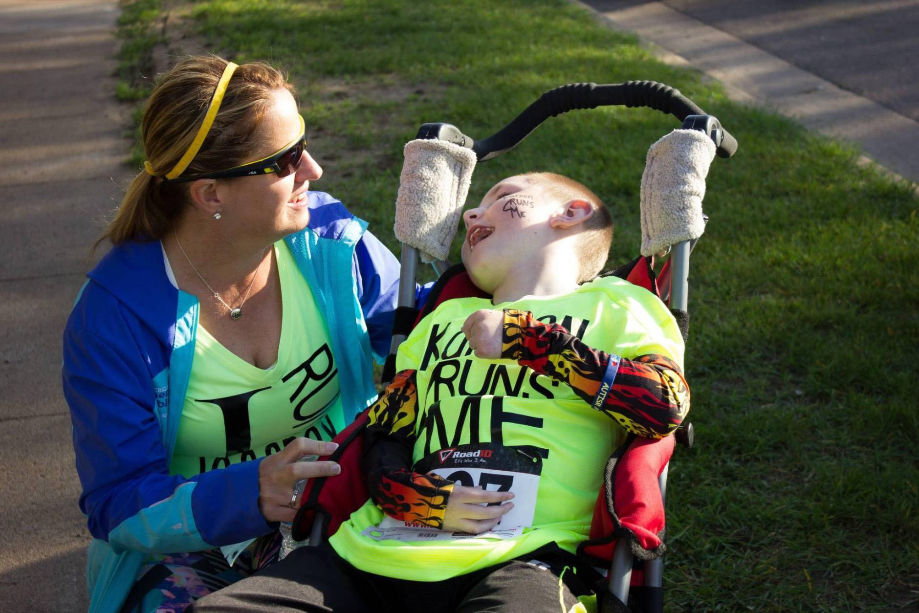 """When Kareen Lawson's feet hit the pavement at this year's Marine Corps Marathon, she won't just be powering herself through the 26.2 mile race. She will also be pushing her favorite 10-year-old buddy, Jeffrey Bergeman, in his running chair. """"He obviously cannot run for himself, so I have the honor of being his legs,"""" she said. They are pictured here at their first race in Wisconsin, where the Bergeman family lives. (Courtesy Michael Ojibway)"""
