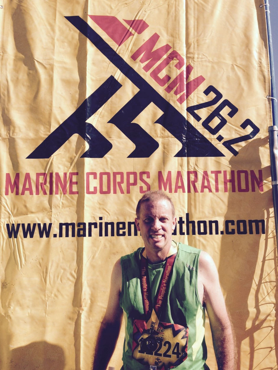 "Jim Anderson has completed all of the Marine Corps Marathons from 2004 to 2015, except in 2011. This photo was taken after he finished the 2014 race. ""I'm just Jim Anderson but I think I represent the story of a lot of people who are doing it for a lot of personal reasons,""  he says. (Courtesy Jim Anderson)"