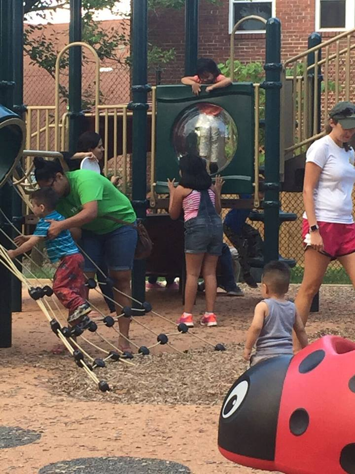 "Alexandria children enjoying the renovated Hume Springs Park. ""Before we came, there was a 10 foot high chain link fence that surrounded the park. It had a very prison-like feel. The lighting wasn't good. There were no trash cans or benches. There was no water fountain. There were no picnic tables. There were no trees and plants,"" Curran says. (Courtesy Brooke Sydnor Curran)"