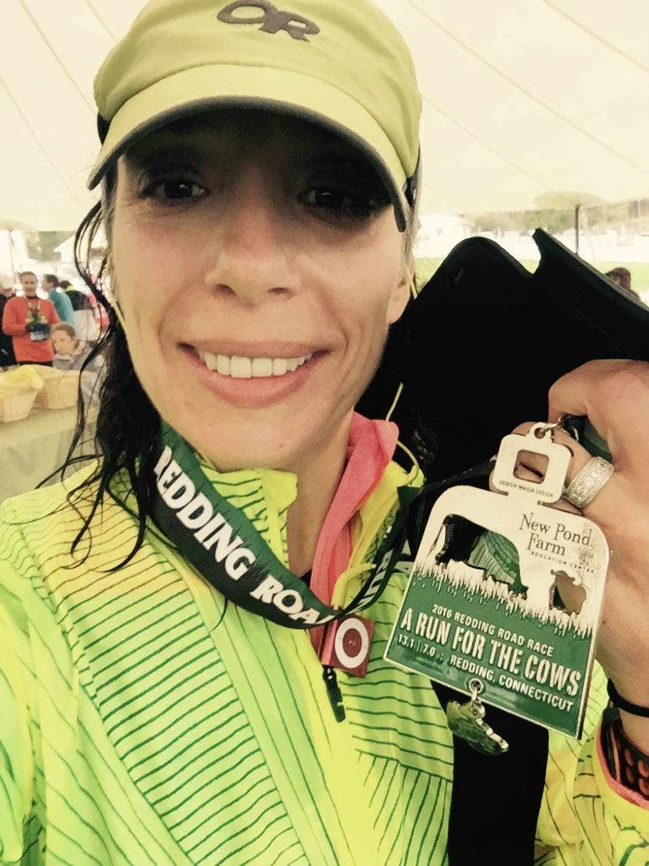 "She started with a 5K and built up her confidence. In February 2016, a colleague suggested running the Marine Corps Marathon. ""I said, 'Okay! Let's do it!'"" This photo shows Lori after completing the Redding Road Race Half Marathon in May 2016. (Courtesy Lori Falcone)"