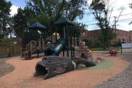 The Hume Springs Park playground in the Arlandria area of Alexandria, Va., underwent renovations in September 2015, as seen in this photo. The nonprofit organization RunningBrooke transformed the space into a family-friendly environment by updating the equipment, adding gardens with native trees and plants, and installing benches and water fountains. (WTOP/Jamie Forzato)