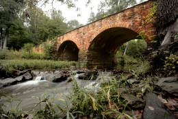 Bull Run Stone Bridge – Manassas, Va.  Originally built in 1825, the Bull Run Stone Bridge sits quietly beside present day Route 29 in the Manassas National Battlefield. A vestige of the Warrenton Turnpike, the dual-arch bridge played a key role in the Civil War. (WTOP/Dave Dildine)