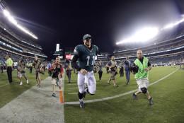Philadelphia Eagles' Carson Wentz runs off the field after an NFL football game against the Pittsburgh Steelers, Sunday, Sept. 25, 2016, in Philadelphia. Philadelphia won 34-3. (AP Photo/Michael Perez)
