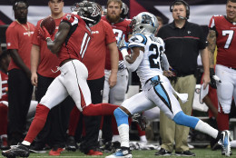 Atlanta Falcons wide receiver Julio Jones (11) makes a catch against Carolina Panthers cornerback Daryl Worley (26) during the first half of an NFL football game, Sunday, Oct. 2, 2016, in Atlanta. (AP Photo/Rainier Ehrhardt)