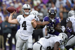 Oakland Raiders quarterback Derek Carr (4) throws to a receiver in the first half of an NFL football game against the Baltimore Ravens, Sunday, Oct. 2, 2016, in Baltimore. (AP Photo/Nick Wass)