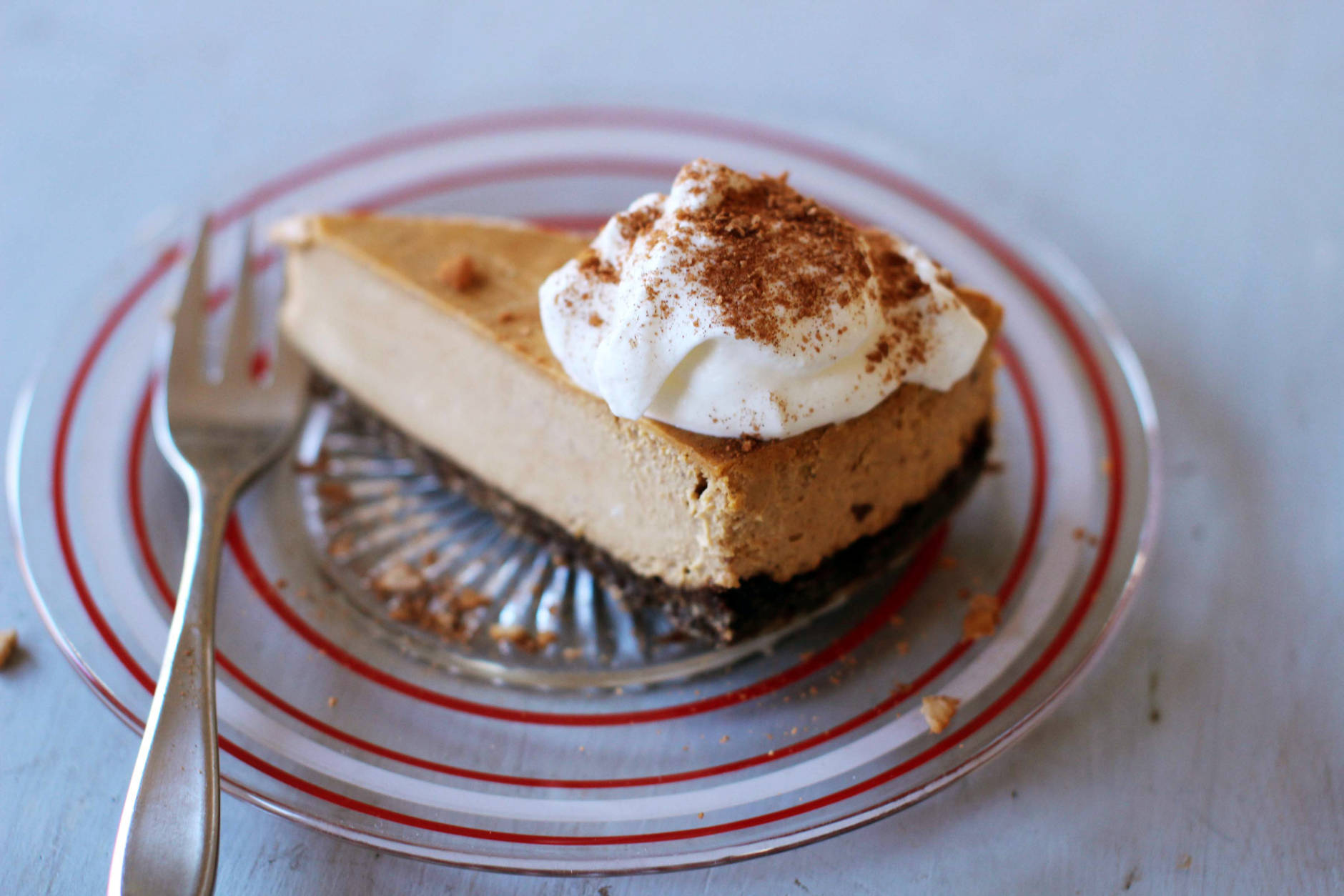 This Nov. 2, 2015 photo shows warm pumpkin bourbon cheesecake in Concord, NH. Serve this cheesecake hot, right out of the oven, topped with a little vanilla ice cream or sweetened whipped cream(AP Photo/Matthew Mead)