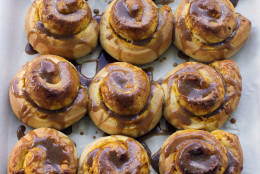 This Sept. 8, 2014 photo shows salted caramel pumpkin buns in Concord, N.H.The bun combines two classics, pumpkin pie and a cinnamon bun, which is topped with a homemade caramel sauce. (AP Photo/Matthew Mead)