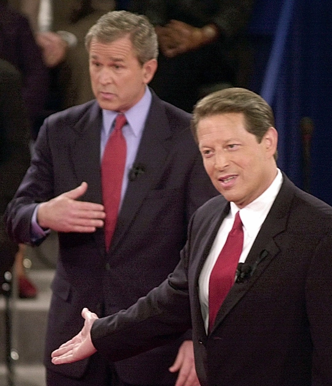 FILE - In this Oct. 17, 2000 file photo, Republican presidential candidate Texas Gov. George W. Bush, left, and Democratic presidential candidate Vice President Al Gore gesture during their third and final debate at Washington University in St. Louis. For presidential candidates, the town hall debate is a test of stagecraft as much as substance. When Hillary Clinton and Donald Trump meet in the Sunday, Oct.9, 2016, contest, they'll be fielding questions from undecided voters seated nearby. In an added dose of unpredictability, the format allows the candidates to move around the stage, putting them in unusually close proximity to each other. (AP Photo/Ron Edmonds, File)