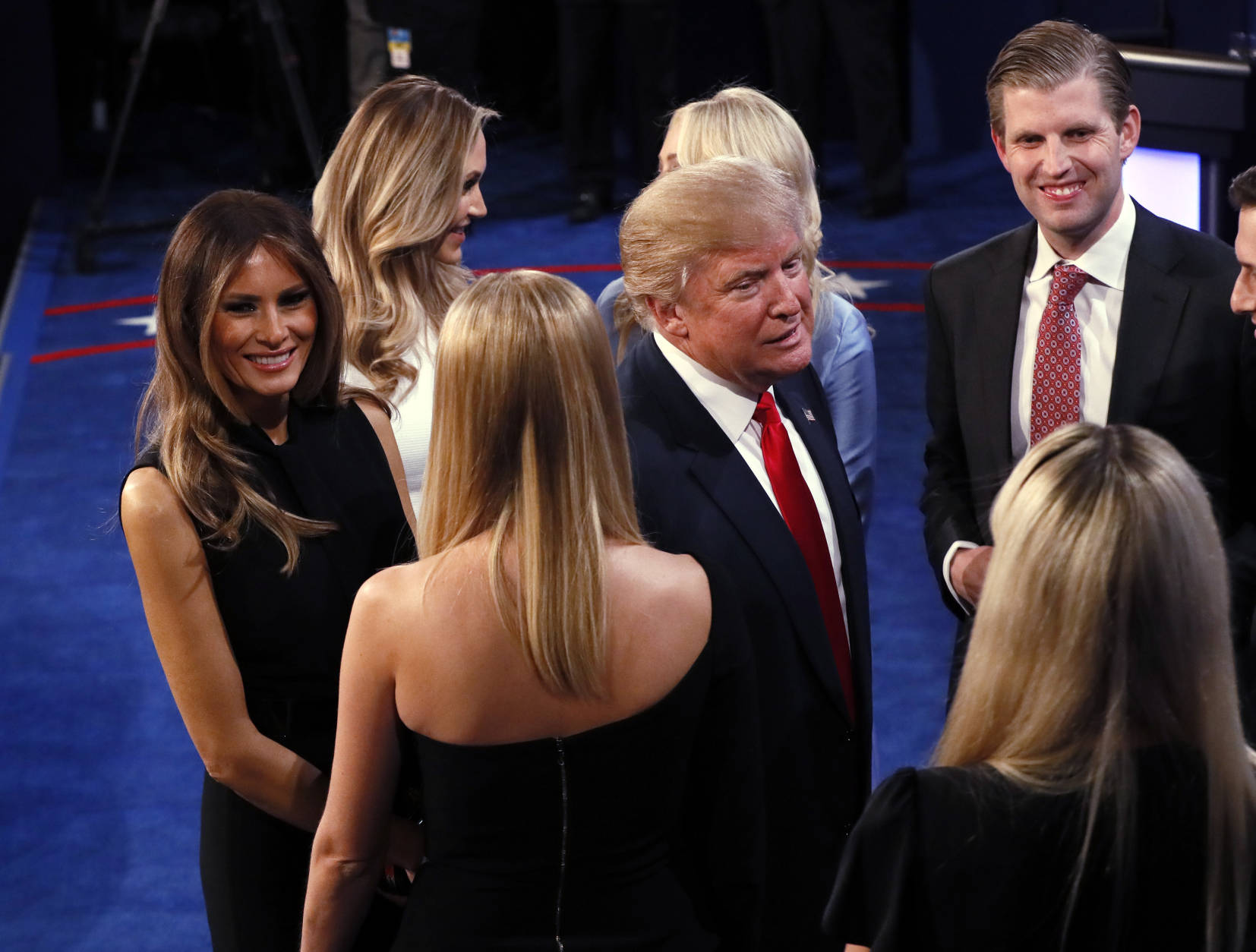 Republican presidential nominee Donald Trump is greeted by his family on stage after the third presidential debate at UNLV in Las Vegas, Wednesday, Oct. 19, 2016. (Mark Ralston/Pool via AP)