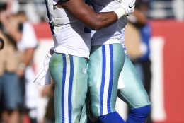 SANTA CLARA, CA - OCTOBER 02:   (L-R) Ezekiel Elliott #21 and Dak Prescott #4 of the Dallas Cowboys celebrates with teammates after a rushing touchdown during the third quarter against the San Francisco 49ers at Levi's Stadium on October 2, 2016 in Santa Clara, California. (Photo by Thearon W. Henderson/Getty Images)