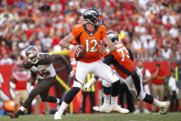 TAMPA, FL - OCTOBER 2:  Quarterback Paxton Lynch #12 of the Denver Broncos looks for an open receiver during the third quarter of an NFL game against the Tampa Bay Buccaneers on October 2, 2016 at Raymond James Stadium in Tampa, Florida. (Photo by Brian Blanco/Getty Images)