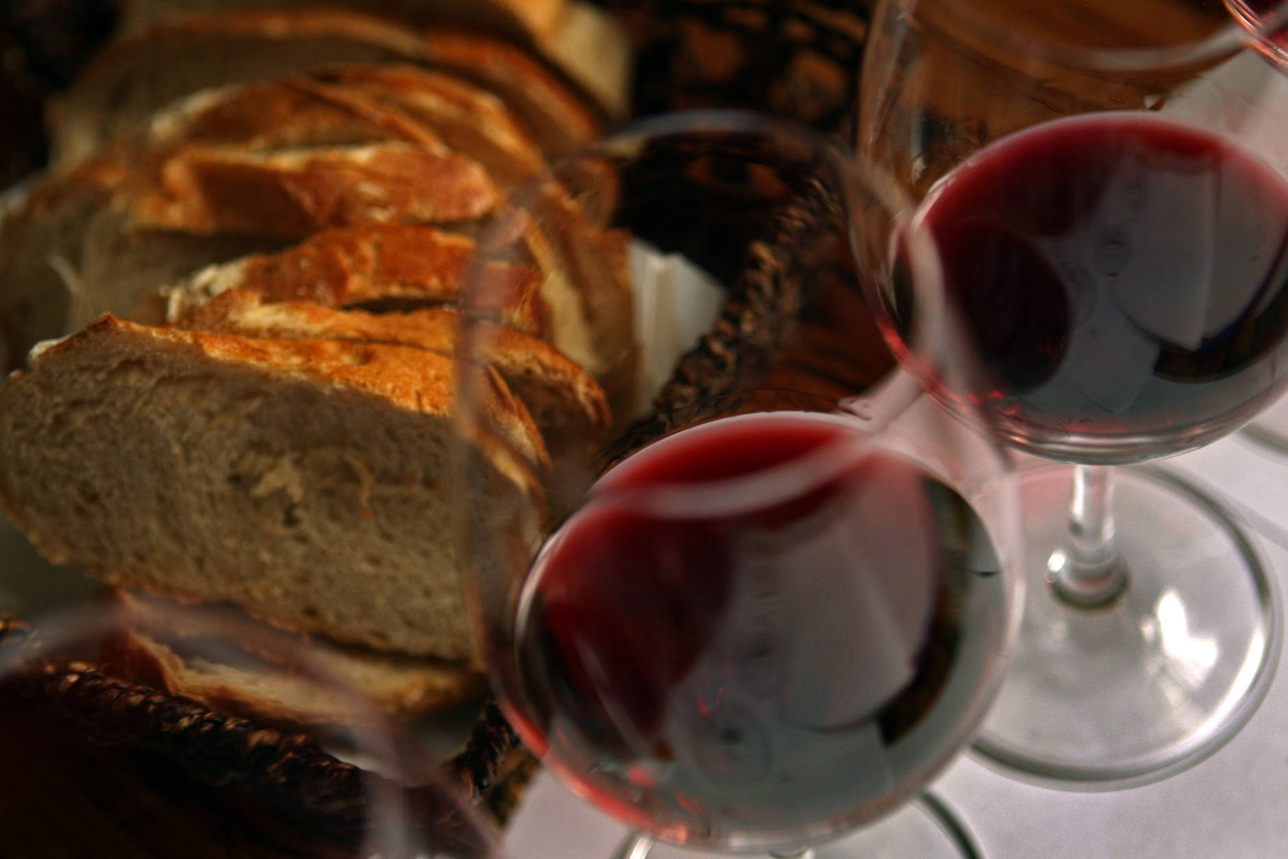 TEL AVIV, ISRAEL - MARCH 25:  Fresh country bread and red wine are served with lunch at the Carmella Banahela bistro on March 25, 2008 in Tel Aviv, Israel. World food prices are soaring in the face of what some analysts are describing as a perfect storm of circumstances; increasing demand from developing economies in Asia, rising fuel prices, severe weather impacting recent harvests and an economic shift to biofuel production. All this leaves the consumer paying more for basic staples such as bread and milk and is likely to have its hardest impact on poorer nations.  (Photo by David Silverman/Getty Images)