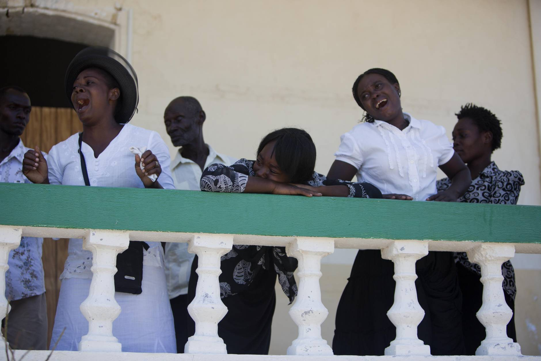 Women from the Laguerre family cry during the burial of Roberto Laguerre in Jeremie, Haiti, Saturday, Oct. 8, 2016. Roberto, 32, died when the wall of a church next door to his home fell during Hurricane Matthew. (AP Photo/Dieu Nalio Chery)