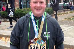"""After months of training, Ron completed a 15K in November 2014 at 212 pounds. """"The only time I used to run before was to run after a food truck, probably,"""" he said. """"At some point, it clicked and I fell in love with it."""" At this point, he had lost nearly 110 pounds in 9 months. (Courtesy of Ron Allison)"""