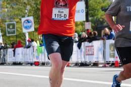 "Ron's photo finish as he completes his first marathon in October 2015, after losing 150 pounds in less than two years. ""The person that handed me my medal said, 'Congratulations, you're a marathon runner.' That's when I broke down. If that was never said, I still probably wouldn't have thought of myself as a marathon runner. It took me a while to even consider myself a runner at that point,"" he said. (Courtesy of MarathonFoto)"
