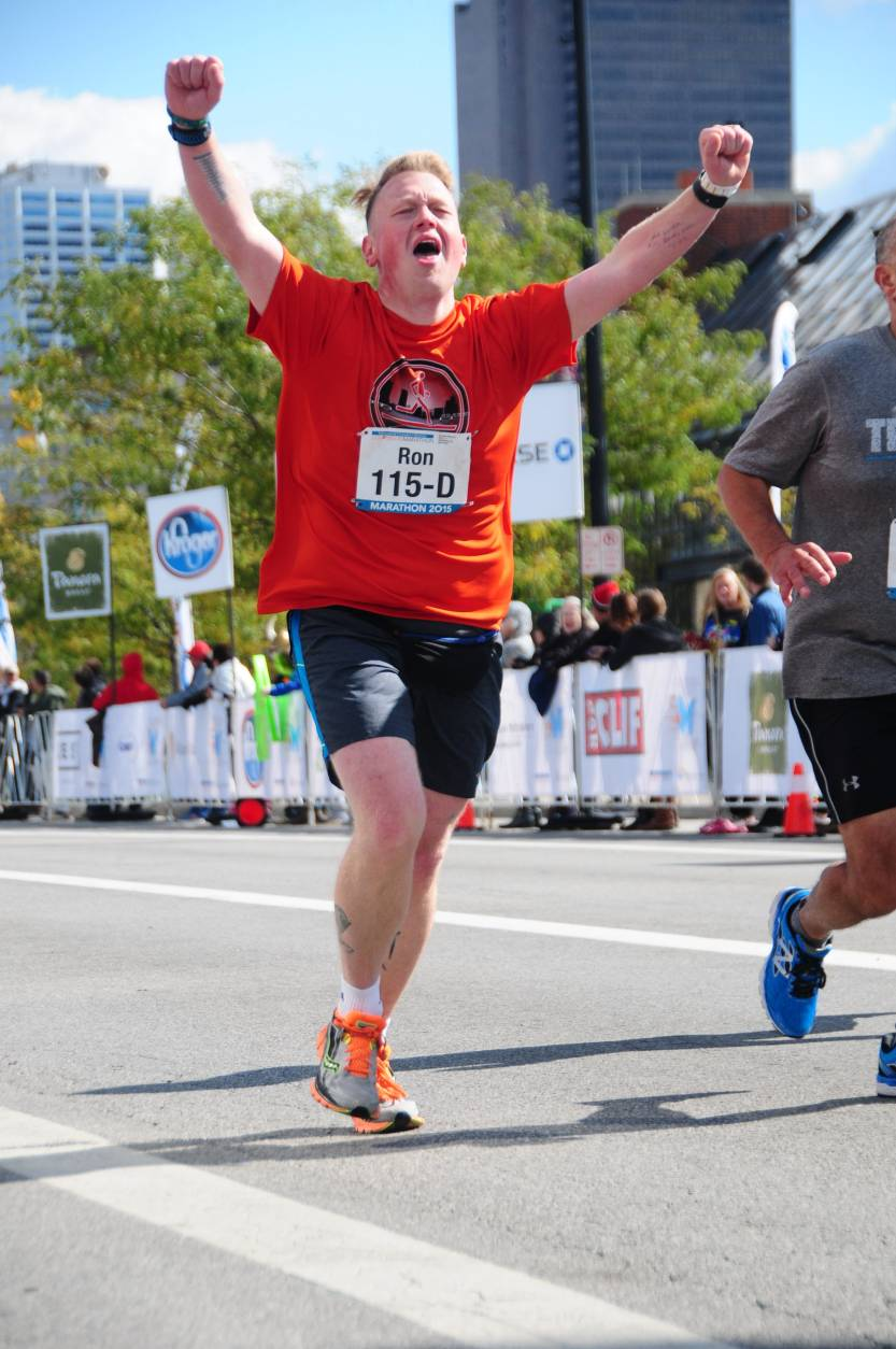 """Ron's photo finish as he completes his first marathon in October 2015, after losing 150 pounds in less than two years. """"The person that handed me my medal said, 'Congratulations, you're a marathon runner.' That's when I broke down. If that was never said, I still probably wouldn't have thought of myself as a marathon runner. It took me a while to even consider myself a runner at that point,"""" he said. (Courtesy of MarathonFoto)"""