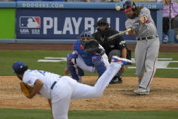 Washington Nationals' Jayson Werth hits a solo home run during the ninth inning in Game 3 of baseball's National League Division Series against the Los Angeles Dodgers, Monday, Oct. 10, 2016, in Los Angeles. (AP Photo/Mark J. Terrill)
