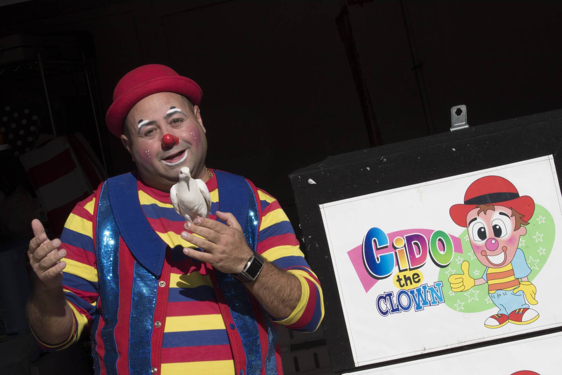 Cyrus Zaveih, also known as Cido the Clown, poses for a photo, Tuesday, Oct. 18, 2016. A spate of scares involving people doing menacing things while dressed in clown costumes has been no laughing matter for real clowns. Some clowns who perform at parties and other private events complain that bookings have fallen off amid creepy clown sightings, some of which have been revealed to be hoaxes. (AP Photo/Mary Altaffer)
