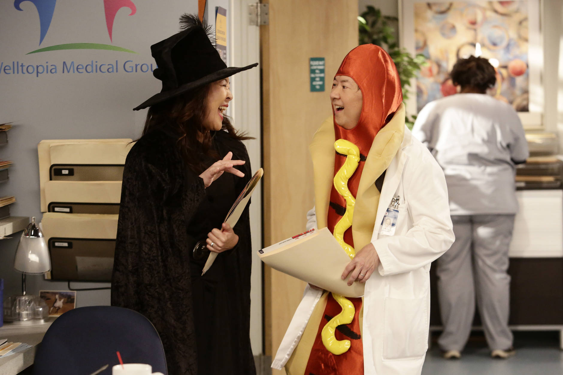 "In this image released by ABC, Suzy Nakamura, left, and Ken Jeong appear in a scene from the upcoming Halloween episode of ""Dr. Ken,"" airing Oct. 21, on ABC. (Nicole Wilder/ABC via AP)"