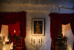 In this picture taken Oct. 9, 2016, a portrait of Vlad the Impaler is hung on a wall in Bran Castle, in Bran, Romania. Airbnb has launched a contest to find two people to stay overnight in the castle on Halloween, popularly known as Dracula's castle because of its connection to the cruel real-life prince Vlad the Impaler, who inspired the legend of Dracula. (AP Photo/Andreea Alexandru)