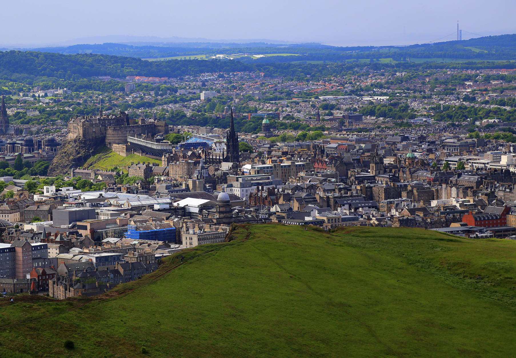 This photo taken June 25, 2016, shows Edinburgh as seen from Arthur's seat. Edinburgh castle is at the left and the spiky black structure in the center is the Scott Monument, commemorating Scottish author Sir Walter Scott. (Michelle Locke via AP)