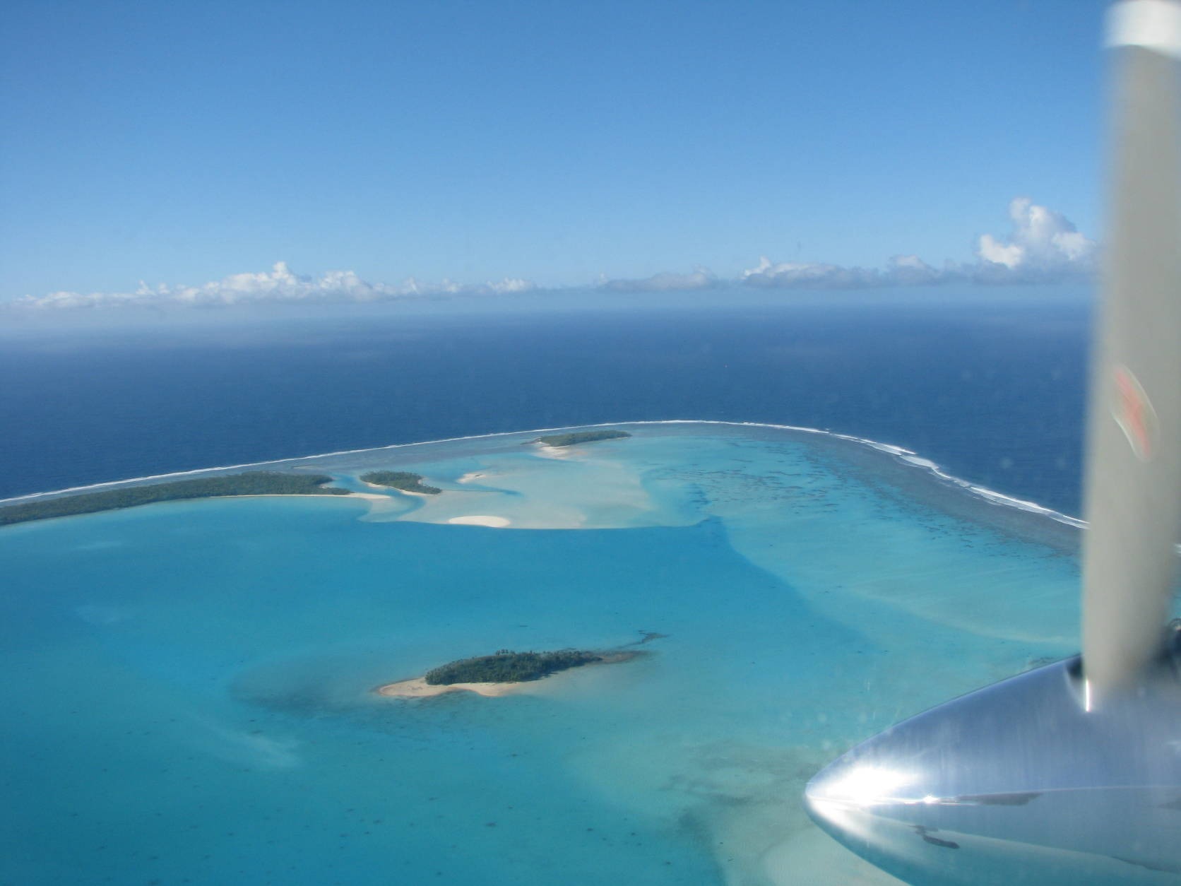 This July 9, 2016 photo shows a flight arriving over the Aitutaki lagoon in the South Pacific's Cook Islands group. A handful of islets inside a reef, Aitutaki is a dream-perfect tropical paradise, minus the crowds and prices, only two flights away from Los Angeles, Sydney, New Zealand and Tahiti. (Giovanna Dell'Orto via AP)