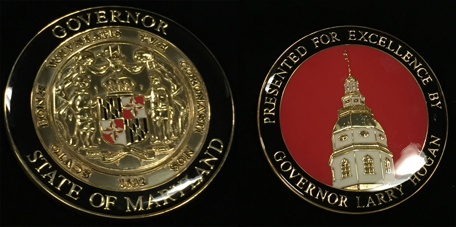 This is the other coin, shown in the photo with both sides, given to the flood heroes from Maryland Gov. Larry Hogan. (WTOP/Michelle Basch)