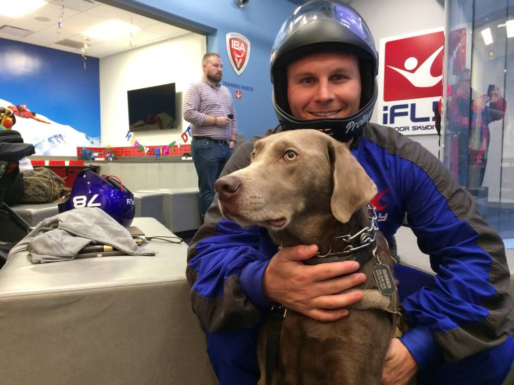 Andrew Einstein and his service dog, Gunner. (WTOP/Noah Frank)