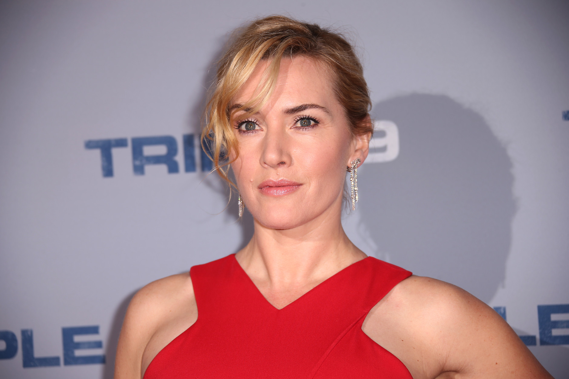 Actress Kate Winslet poses for photographers upon arrival at the premiere of the film 'Triple 9' in London, Tuesday, Feb. 9, 2016. (Photo by Joel Ryan/Invision/AP)